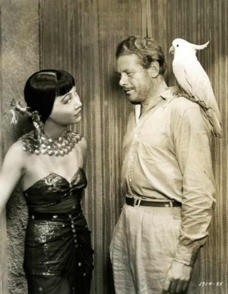 Anna May Wong, Charles Bickford and a fine feathered friend Daughter Of Shanghai - (1937)