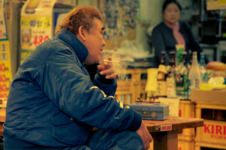 "PEOPLE OF JAPAN 20 - ""JAPANESE UNCLE BUCK?"" A few days back I posted another photo of this amazing man along with a quiz question asking which 80's comedic actor he resembled. I had an overwhelming two participants which I'm pretty sure means that my blog briefly went viral. Anyway, congratulations to John Carleton and Drew Shannon, you both answered correctly, the correct answer was indeed John Candy! As you two read this imagine me throwing some popcorn in the air and Vicki yelling ""Yay"", because unfortunately that's the only prize you guys will be getting. I was going to give the winner a nice gift certificate to Applebee's but since you guys tied I decided to just throw it in the trash.  Anyway, everyone should follow John and Drew now as they are two cool guys who are not afraid to answer the tough questions."