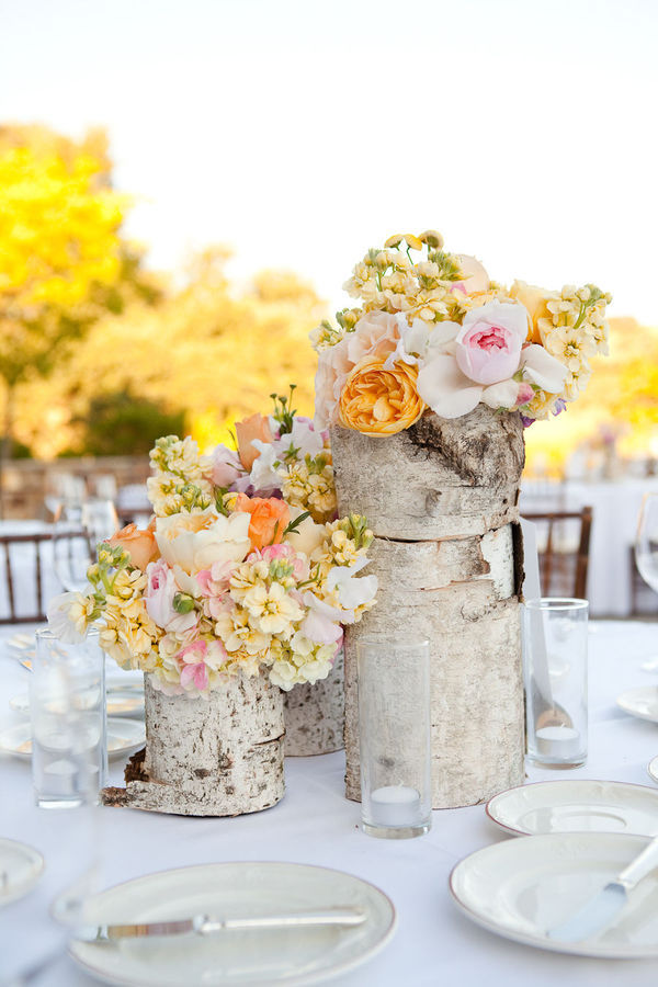crystalandjaron:  goingtothechapel:  I always love these wooden centerpieces.   Me too!
