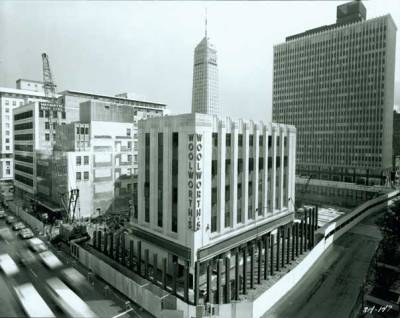 thomaslowrysghost:  Demolition of the old Woolworth's Store in downtown Minneapolis.  Photographer: Norton & Peel Photograph Collection 5/29/1970 (photo via MHS Visual Resources Database) After the IDS Building was erected here, Woolworth's moved into a first floor storefront (now occupied by The Gap, if they're even still there).   And what stands in its place these days? Just another parking lot with a random skyway leading to nowhere, a sketchy parking ramp on the opposite corner, and a former McDonalds which was briefly the BC night club which has lied vacant for several years now.