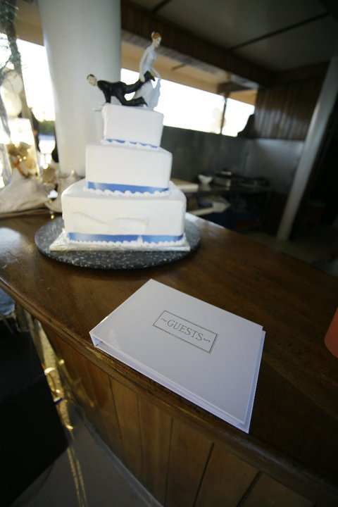 …just going through some of the wedding photos….. ah…..my poor cake …. was doomed from the beginning…. as you can see it was carried so many times from the resort, onto a bus, passed the beach, on a motor boat… onto the big yacht where it is sitting on the counter here in the picture… so the layers started to slide/tip over…. but it stayed standing until the very end when we cut it and ate it all up….. and it was sooo good… it was a white icing (vanilla) cake with banana cream in the middle and was served with pineapples and pineapple sauce…. mmmmmm….