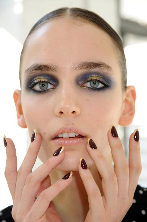 Jason Wu. The nails are gorgeous (hard to believe this is inspired by the concept of the French manicure — it is so much better) and the makeup is amazing.