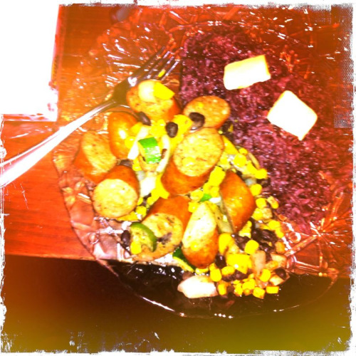 Dinner by Emily: Chorizo sausage with corn, black beans, zucchini and onions. Leftover purple Jasmine rice on the side.