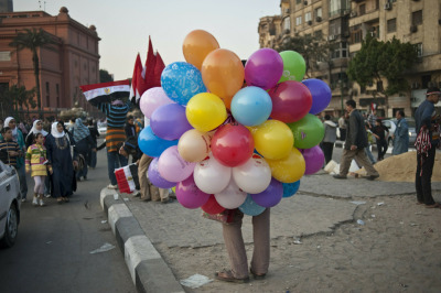 inothernews:  A street vendor sold balloons Thursday in Cairo's Tahrir Square, the  site of protests that ended with Egyptian President Hosni Mubarak ceding  power earlier this month. (Photo: Pedro Ugarte / AFP-Getty via the Wall St. Journal)