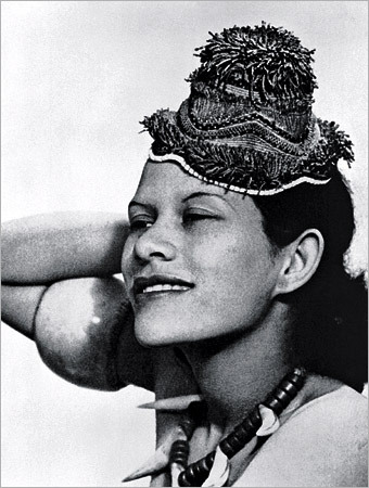 Adrienne Fidelin, photographed by Man Ray for the September 1937 issue of Harper's Bazaar. This makes her the first black model to appear in a major fashion magazine. © Lee Miller Archives, England 2007. All rights reserved. Man Ray/Telimage