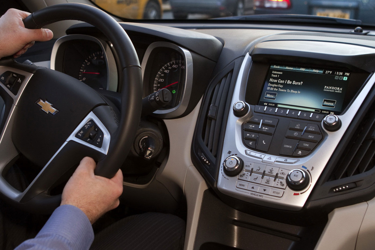 Chevy Launches MyLink Infotainment System in Response to Ford's SYNC  The 2012 Chevrolet Volt and Equinox models will be the first to offer Chevy MyLink, an in-car infotainment  equipment that integrates internet radio, hands-free, voice and  touch-screen controls, all of which can be accessed via Bluetooth  connectivity. Three  years ago, Ford introduced a similar system, called SYNC, whose aim was  to reunite in a friendly and efficient way the various in-car controls  that a driver can access while driving. Now Chevy is ready with its own technology, developed together with GM's subsidiary OnStar. MyLink  provides drivers with stereo audio streaming, wireless control of  smartphones, voice-activated commands and a full-color 7-inch touch  screen display that centralizes media sources. For example, the driver  can initiate phone calls, select radio stations or stored media only by  using his voice. Other  features are Pandora internet radio, which allows users to personalize  their radio experience, or Gracenote, which identifies the user's music  collection and presents information such as artist name, genres and  album cover art on the MyLink screen.   (vía Carscoop)