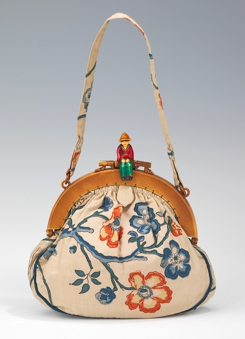 omgthatdress:  1930s purse via The Costume Institute of The Metropolitan Museum of Art  there is a person. on this bag. hannah wants little figures of people on all of her bags. then she will name them and make them talk to each other.