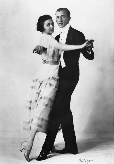 Vernon and Irene Castle were a husband-and-wife team of ballroom dancers of the early 20th century. They are credited with invigorating the popularity of modern dancing. Vernon Castle (2 May 1887 - 15 February 1918) was born William Vernon Blyth inNorwich, Norfolk, England. Irene Castle (17 April 1893 - 25 January 1969) was born Irene Foote, the daughter of a prominent physician in New Rochelle, New York. In addition to cabaret, the Castles also became staples of Broadway. Among their shows were The Sunshine Girl (1913) and Watch Your Step (1914), which boasted a score written byIrving Berlin with them in mind. Emerging as America's premier dance team, the Castles were trendsetters in a number of arenas. Their infectious enthusiasm for dance encouraged admirers to try new forms of social dance. Considered paragons of respectability and class, the Castles specifically helped remove the stigma of vulgarity from close dancing. The Castles' performances, often set to ragtime and jazz rhythms, also popularized African-American music among well-heeled whites. Irene's fashion sense, too, started national trends. Her elegant, yet simple, flowing gowns were often featured in fashion magazines. She is also credited with introducing American women to the bob—the short hairstyle favored by flappers in the 1920s. The whisper-thin, elegant Castles were trendsetters in many ways: they traveled with a black orchestra, had an openly lesbian manager, and were animal-rights advocates decades before it became a public issue. Irene was also a fashion innovator, bobbing her hair ten years before the flapper look of the 1920s became popular The Castles endorsed Victor Records and Victrolas, issuing records by the Castle House Orchestra, led by James Reese Europe –– a pioneering figure in Black music. The Castles' greatest success was on Broadway, in Irving Berlin's debut musical Watch Your Step (1914). In this extravaganza, the couple refined and popularized the Foxtrot, which vaudeville comedian Harry Fox is believed to have invented. After its New York run, Watch Your Steptoured through 1916.