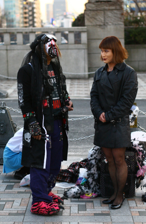 a slipknot member? Nope, just a normal day in Harajuku, Tokyo where cosplay kids and gothic lolitas gather to hang out. Nice slippers.