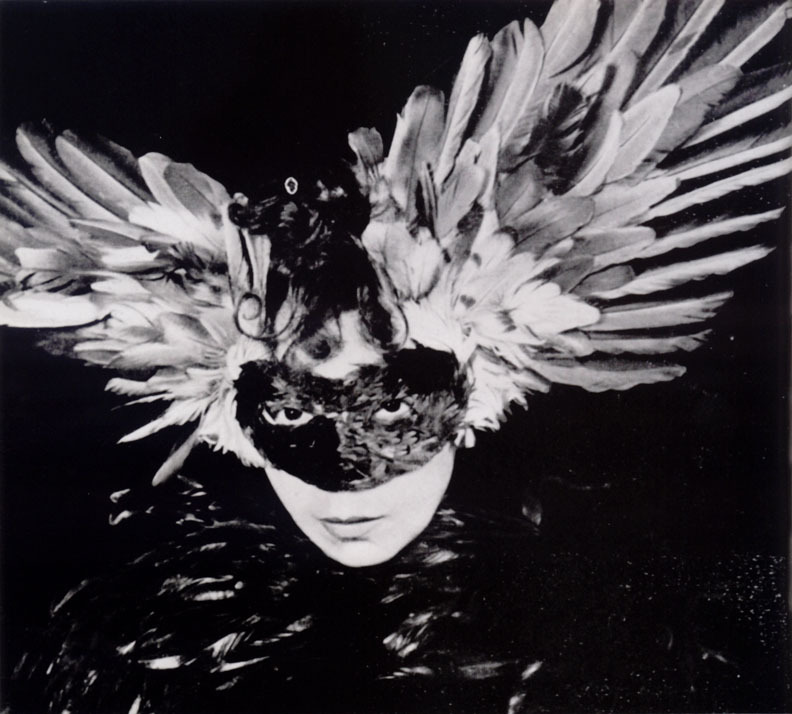 billyjane:  Leonor Fini * wearing a feathered mask [Vogue, album d'hiver], 1946 from Ghislaine Wood, The Surreal Body, Fetish and Fashion