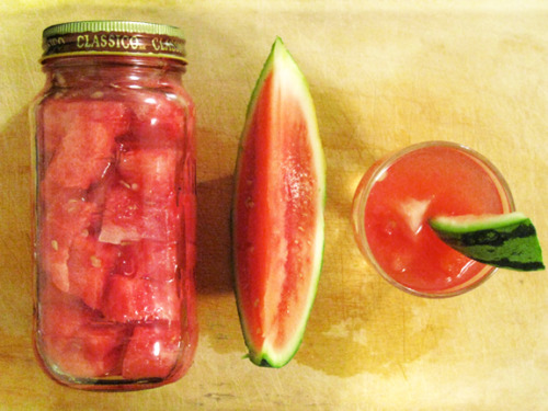 Watermelon with vodka, two ways. No. 1 I jabbed the vodka bottle in the melon and let it sit for 2 weeks. (Instructions here). No. 2I filled a jar with cubes of watermelon and added the vodka. I let this sit in a dark area for 2 weeks. The verdict is… I prefer the jar infusion. I strained the vodka through a coffee filter, and am now enjoying it straight from a shot glass. Nom nom. Photo credit: Lush Lady