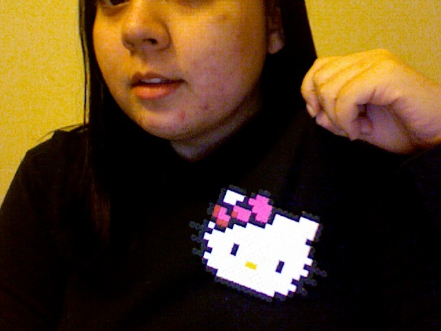 Hello Kitty! As a pin! It's a bit big, but that's because it's so awesome!