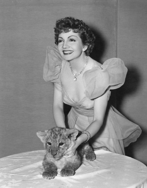 Claudette Colbert and a little friend