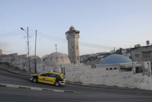 The walls of the Old City of Hebron earnestly bathing in the light of the late afternoon.