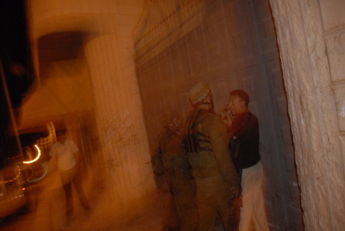 Two international human rights observers in Hebron, The West Bank, are assaulted after trying to observe soldiers raiding a Palestinian home.