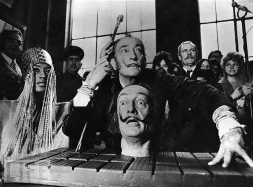 Monday Dali [revisited] poses with a model of his own head, at a press conference in Paris in 1973  from LIFE / an earlier 'tableau vivant' here