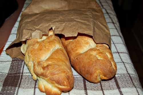 I love bread!  I have always wanted to make bread from scratch! This recipe is for a french stick or baguette.  What you need: 1 packet of dry active yeast 1 tsp sugar 1.5 cups warm water 4 cups of all purpose flour 2 1/2 tsp salt Tbsp olive oil  Mix dry active yeast with sugar and warm water and let stand for 10 mins.  Add flour 1 cup at a time and mix, then add salt.  Mix until sticky.  Knead on a floured surface and place in an oiled bowl turning dough to cover it in oil. Cover bowl with a towel and leave to rise 1.5 hours or until doubled in size. Preheat oven to 475 degrees F Punch dough down and form into loaf or 2 small loaves cover with towel and let rise for 30 mins.  Cut a few slits into loaves and brush tops with water. Bake for 22 mins. I made sandwiches once they cooled, and used the leftover bread going stale to make garlic bread.