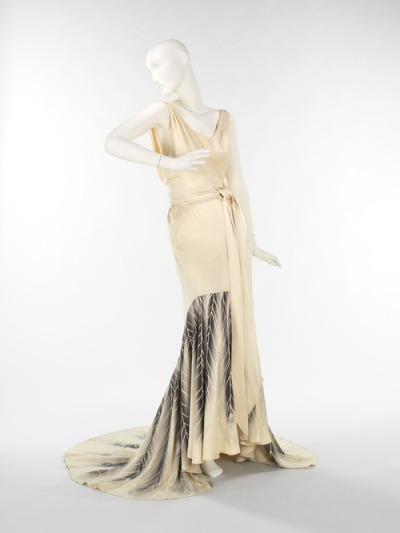 Ways to wear a 1932-34 evening dress. Also, the best things about this decade were the exposed backs.