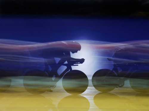 TRACK WORLD CUP: BRITISH TEAM PURSUIT   This is an amazing photo from the Track World Cup in Manchester.  The photographer (Tom Jenkins) uses an off-camera flash pointing back towards the camera to freeze the subject and a slow shutter speed of 1/4 sec at F16 to blur the other cyclists.  Read about Britain's Gold Medal ride at The Guardian.