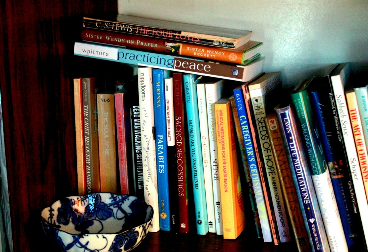 "I have a thing about bookshelves; they have magnetic power over me. The volumes that line certain bookshelves have the potential to change the world. Of course, one has to read the books first. I visited the St. Francis House of Prayer meditation center not long ago. I wandered around the grounds and throughout the house. Each room offered sacred space with panoramic vistas of the rural countryside, but I planted myself, with a cup of orange spiced tea, in the room with the books. They called to me as they always do. ""Read us,"" they said, and ""we will show you heaven on earth."" And I believed them."