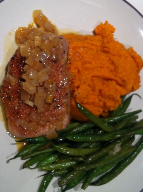 Dinner by me:  Boneless pork chop with an orange and white wine pan sauce, mashed sweet potatoes, and green beans sautéd in mirin.