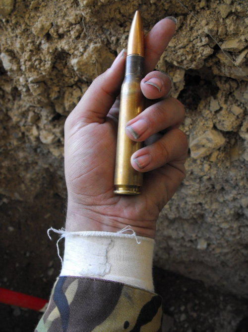 sunshineandscrewdrivers:   You see that bullet? It belongs to a .50 caliber. You know how many inches it is? About 5. You know who's taking the hits? Libyans. Do you know how much of an impact this is on a person's body? It tears them apart. Gaddafi you are a terrible, terrible man.  Subhan'Allah.  Words cannot express how I and many others feel about you right now.  I am going to reblog every single image of this ammunition because it should never, ever, ever be used on a human being. PERIOD.