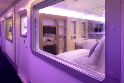 "The Yotel concept was inspired by Japanese capsule hotels, those hostels in Tokyo and Osaka that some liken to sleeping in a drawer. Except, Yotel does not have coffin-like beds stacked one atop another like some capsule hotels do. Instead, Yotel has cozy (read, ""small"") private rooms designed to provide a weary air traveler the maximum of comfort and convenience using a minimum amount of space. And for a minimum of cost. Every Yotel room (referred to as a ""cabin"" in Yotel parlance) includes free in-room wireless internet, a flatscreen television, an en-suite bathroom with rain shower, a fold-out desk and 24-hour room service. Every cabin also has plenty of power outlets for recharging your travel gadgets, and a bed with quality sheets and a premium mattress for recharging yourself. Yotel currently has locations at Schiphol Airport (Lounge 2) in Amsterdam and in London at Gatwick (South Terminal) and Heathrow (Terminal 4). Rates for a standard cabin start at €35/£25 for the first four hours and €8/£6.50 each hour after that. Premium and twin cabins are around 60% more."