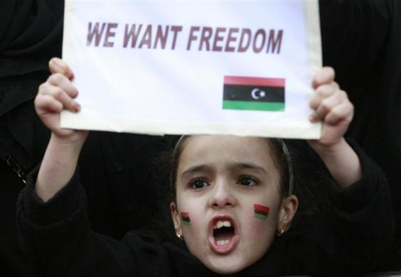 thepoliticalnotebook:  A child demonstrator protesting against Gaddafi outside the Libyan Embassy in London February 20, 2011.   Photo Credit: REUTERS/Luke MacGregor