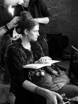 Daiane Conterato has hair styled backstage at Peter Som F/W 11 (Photography: Damien Neva)