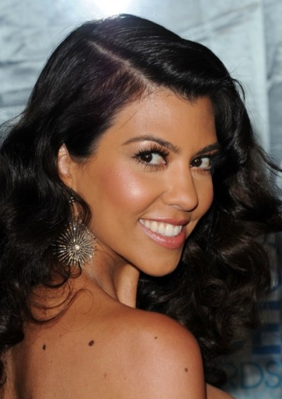 "FROM KOURTNEY KARDASHIAN'S BLOG: ""JOYCE'S Guide to Creating My PCA Look""  Joyce is one of my best friends and she does my makeup!! We go on all kinds of adventures together like vintage clothes shopping, vintage furniture shopping, all sorts of crazy stuff! Her outfits inspire me every day that I see her! She has my back and makes sure that I win the gorgeous award! Lol! Joyce has put together a step-by-step guide to creating my People's Choice Awardslook. Read her guide here. Joyce also has blog you can check out.  STEP 1: KOURTNEY'S SKIN DON'T FORGET GIRLS!! It's very Important to keep up on your skincare regimen to keep its glamour & to help you have a clean smooth look. On Kourt I apply PerfectSkin & PerfectSkin eye cream. To condition lips I used Clarks Botanicals Ultra Rich Lip Balm. *Don't be lazy, this also goes for using a cleanser on your pretty little face at night as well! If ONE night you happen to be too tired, use makeup remover wipes. STEP 2: PRIMER I used Photo Finish Foundation Primer by Smashbox. *On warm summer days try cooling your Foundation Primer in the refrigerator for refreshing the skin and reduce puffiness. STEP 3: FOUNDATION I used Photo 'Perfexion by Givenchy. When blended into the skin with a foundation brush for a flawless touch, this foundation gives a smoothing concealer effect with a weightless wear and a radiance ""projector."" STEP 4: UNDER EYES I use Secret Camouflage by Laura Mercier.  *this product is the perfect trick for completely camouflaging dark circles, minor imperfections, and discoloration. STEP 5: SET Finally I set Kourt's entire face with Smashbox's Photo Set Finishing Powder with SPF 15. *this is perfect to keep makeup from melting away under the hot lights of a photoshoot or on the red carpet.  REMEMBER don't use too much of this, just a little touch is all you need. STEP 6: BROWS I tweezed them using Tweezerman tweezers. Then filled them in with Benefit's Brow Zing. *use an angled brush and apply soft strokes of the pigmented wax to shape and define the brow, then take your small blending brush to apply and set the brow zing's powder to fill in sparse areas and lock the brows into place. STEP 7: KOURTNEY'S EYES To prime the lid I used Eyeshadow Primer Potion in Tawny Matte Finish by Urban Decay topped with Eyeshadow in Chopper by Urban Decay. *this is the perfect color for giving off a smokey dark golden pinkish glam look. M.A.C. has the perfect Eye Kohl in Smolder that I used to line Kourt's upper inner eye line.  I also give a thick line on top of the lid close to the lash line. Remember, to finish off the eye, I curl her lashes using Shu Uemura eyelash curler.  I gave Kourtney her lush lashes with Plush Lash by M.A.C.. STEP 8: KOURTNEY'S CHEEKS On the hollow of her cheeks I applied Bronzing Powder in Laguna by NARS. To give give that pinkish glow, I used a touch of CORALista Blush by Benefit to give a sheer natural hint of color. STEP 9: KOURTNEY'S LUMINOUS GLOW I applied Lust Dust by benefit right above the hollows of her cheeks & bridge of her nose. STEP 10: KOURTNEY'S LIPSFirst I lined her lips with a The Essential Pencil in Nude by Trish McEvoy. *Although this is a matte finish it helps to extend the wear of your favorite gloss or lip color. Next, I applied and blended lipstick in Pink Innocent by Trish McEvoy. I finished her lips with FUSION BEAUTY's Lip Fusion inFATuation in La Lip Jolie to give the glossy coat. XO,Joyce Bonelli@JoyceBonelli"