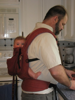Sarah Jane cooking with her daddy in the Ergo. She fell asleep 10 minutes after this picture was taken!  Submitted by Amie