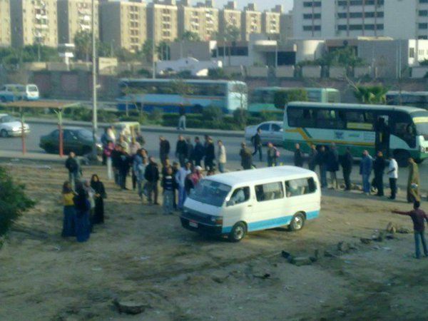Egyptians lineup to get on board a microbus. Wait wait wait. Did I just use Egyptians and lineup in one sentence? Phenomenal developments! Sidebar: I kinda can't wait to go back! This picture is proof of change. BTW: this is my 1,100th post.