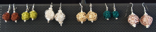 Chorus line of hand-wrapped wire earrings by PSjewelryworks.com