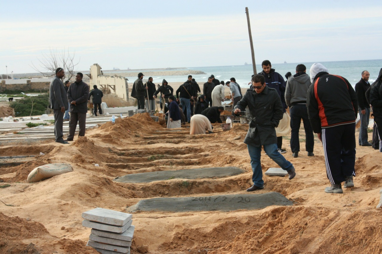 A handout picture obtained from OneDayOnEarth.org shows Libyans preparing graves for a mass burial of alleged victims of the ongoing anti-government protests in the Libyan capital Tripoli on February 22, 2011. (OneDayOnEarth.org/AFP/Getty Images)Editorial: UN Human Rights Council predictably silent on LibyaPlanes, ships headed to Libya to evacuate foreignersMore than a quarter of Libyan oil output shut down