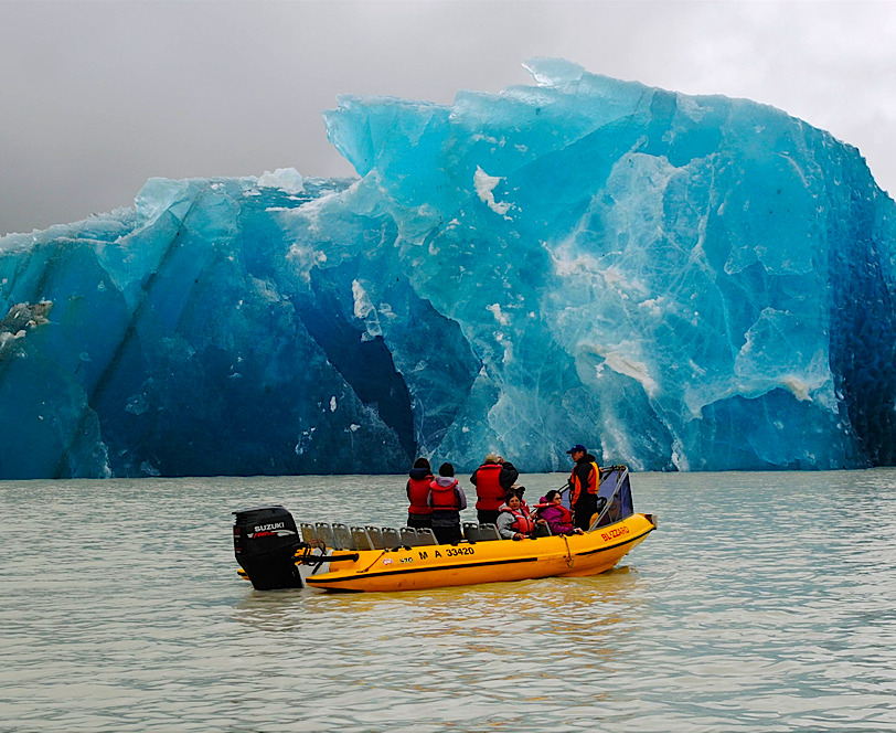 kateoplis:  A group examines one of the many icebergs that calved into Tasman Lake as a result of the 6.3 earthquake in Christchurch. Photo: Denis Callesen/AP Big Picture