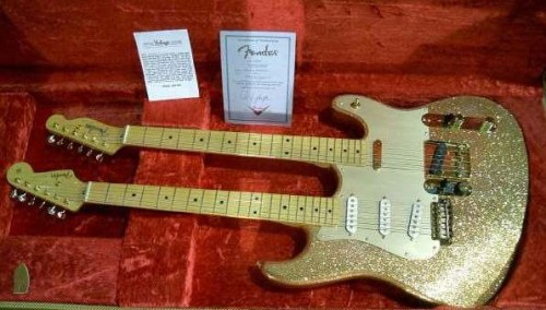 And for those of you who can't decide between a Strat and a Tele, how about this 2002 Fender Gold Sparkle Doublecaster?