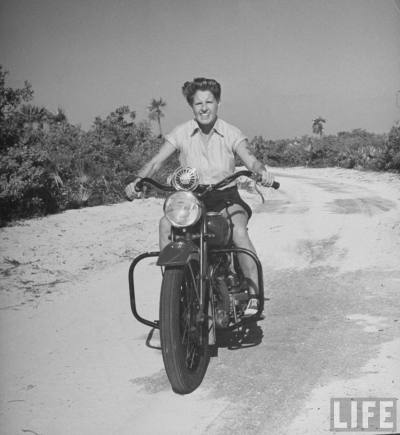 Betty Carstairs riding her motorcycle in Nassau, the Bahamas (1941).  Betty (1900–1993) was a wealthy British power boat racer known for her speed and her eccentric lifestyle.