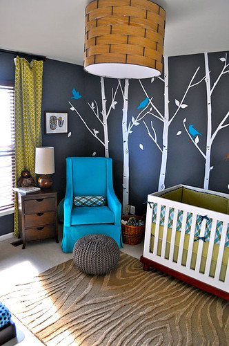 in LOVE with this nursery LOVE the wall color love the trees with the birds painted on the wall very cool rug Love the color of the chair the shades are beautiful Neat light fixture