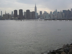 "seamonstery:  Brooklyn, NY The East River. Again, I know. But it's so pretty, and I have a story for you. For the last 8 months I've lived within two blocks of this river. Back in November, I told a certain fellow I was (and still am) dating that I'd never actually been to the waterfront. Mostly because within this neighborhood, the waterfront consists almost entirely of warehouses and docks which aren't exactly safe to stumble around by yourself. The next time I saw him, he came to my neighborhood and we went for a walk to grab Thai food. On the way home, he started walking in the wrong direction. I told him, ""My apartment's this way,"" but he took my hand and told me he had something else in mind. He brought me here, where we stood on the rocks with the breaking waves, and neither of us said anything. He gave me a kiss, pulled out a bottle of red wine, and then asked me to tell him about sea monsters while we ate. It's one of my very favorite memories in this city."