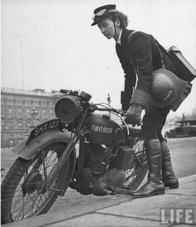 Female dispatch rider getting ready to mount her moto. (United Kingdom, 1941)