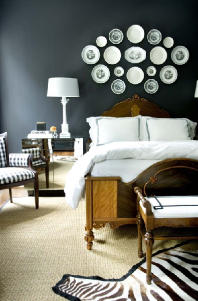 A bedroom designed by Courtney Giles with deep tones and masculine touches - but still feels feminine.  Love the zebra rug!