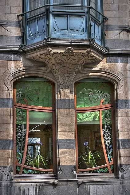 Art Nouveau Windows, Ixelles, Belgium — jkravitz There  are many beautiful art nouveau houses in Ixelles  (a neighborhood of  Brussels). These organic curves are typical of this style of  architecture.