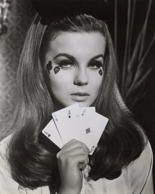 This looks like Ann-Margret, from a photo shoot in support of The Cincinnati Kid (1965). But I could be wrong.
