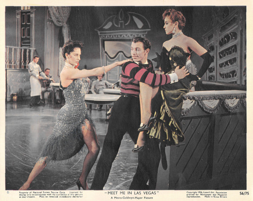 Lobby card for Meet Me in Las Vegas (1956).