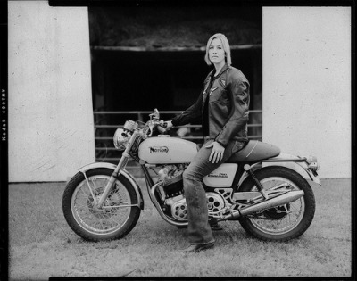 Woman on a Norton [side note] I'm pretty sure this photographer has done a series of Women and Motorcycles. I've seen a very similar photo in style, with the same border. I want to know who did them- because they're quite lovely. Thank you to readers easilyerased and truebikerspirit for sending me the crediting information for this photographer. I appreciate it! (more here)