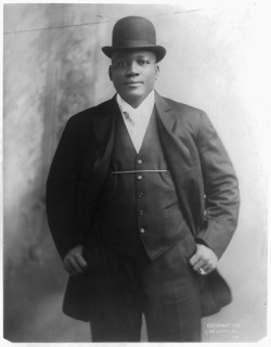 "This is Jack Johnson, the first African American national heavy-weight boxing champion of 1910-1915.  His famous match against Jim Jeffries, a white, then retired former champion, was fueled with racial tension.  Jeffries spoke of himself as the ""Hope of the White Race"" (in hopes to win the championship title back for white people).  Jeffries defeat caused riots in the streets of many cities nationwide; so much that Congress actually passed a bill outlawing fight films in movie theaters. The videos of the fight on YouTube are great."