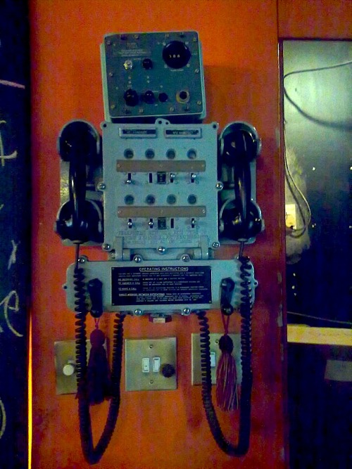 "Telefoonsentrale Taken at Die Boer theatre. Melancholy robot. I had a gig with Schalk Joubert last night. None of the audience members left before completion of said gig. Surely a milestone for Durbanville's discernment!  I always forget that a gig with Schalk involves an afterparty. We lived it up with his groupies in the office/dressing room until 00:30 when a sense of responsibility kicked in and we decided to rather buy three bottles of wine and continue our soirée on Monterosso.  There was dancing, karate, dam-swimming and other activities. Upon waking this morning Chopper (who only had three cups of coffee and a cream soda) made the remark: ""Last night: party animals, this morning: roadkill."""