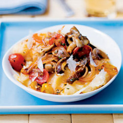 Wild Mushroom and Tomato Ragout 1 T olive oil 1  shallot, peeled and thinly sliced 1 t balsamic vinegar 1 t tomato paste 2 cup sliced assorted mushrooms (such as cremini, shiitake, and oyster)  3-1/2 cups low-sodium vegetable broth, divided 1 cup grape tomatoes, halved 1 t chopped fresh rosemary (or 1/2 teaspoon dried) 1 t chopped fresh sage (or 1/4 teaspoon dried) 2/3 cup quick-cooking polenta 2 T shaved Parmesan (optional) Directions Heat olive oil in a skillet over medium heat. Add  shallot and vinegar and cook for 2 minutes. Add tomato paste and  mushrooms; cook for 5 minutes, stirring occasionally. Pour in 1/2 cup broth, bring to a boil, and reduce  to a simmer. Cook for 5 minutes. Add grape tomatoes and cook 5 more  minutes until sauce thickens slightly. Remove from heat. Bring 3 cups of broth, rosemary, and sage to a boil in a medium saucepan. Slowly pour in polenta. Cook over medium heat, stirring constantly for 4 to 5 minutes until mixture thickens. Spoon polenta into four bowls and top each with a portion of mushroom ragout and a sprinkling of Parmesan. Four servings. One serving (2/3 cup polenta, 2/3 cup ragout): 164 calories, 5 g fat (26% of  calories), 1 g saturated fat, 26 g carbs, 4 g protein, 2 g fiber, 55 mg  calcium, 2 mg iron, 177 mg sodium