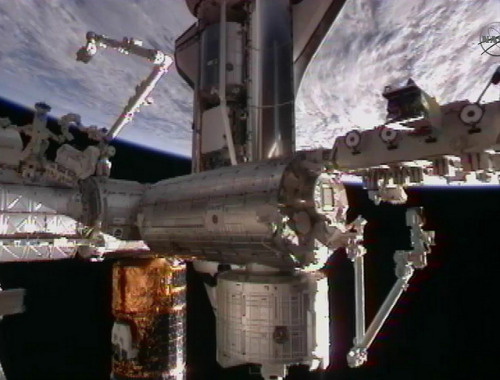 Historic view of ISS after docking of Discovery, with ATV, HTV, Progress and 2 Soyuz all docked (by European Space Agency)