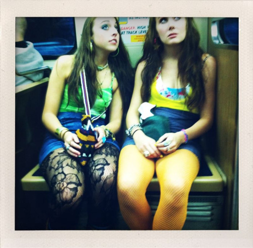 kerryabdow:  chicago. southbound el train. 5:27 am. i was heading to the airport to visit fort bragg for the first time. loved the art school girls with very dilated pupils… the better to seeeeee you weeth!  leaving a party? probably. notice one has her shoes in her bag. barefoot on the el…  yikes…   Holy. Hell. what are those things?  Oh, they're people. Yikes. Fashion Disasters.